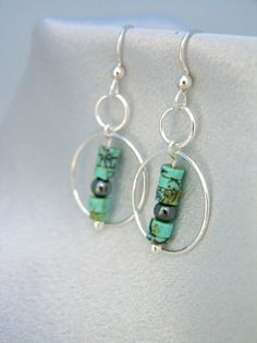 South of the Border Silver & Turquoise Cocktail Earrings by On the Rocks Designs. American Made. See the artist's work at the 2014 Buyers Market of American Craft, Philadelphia, PA. January 18-21, 2014. americanmadeshow.com