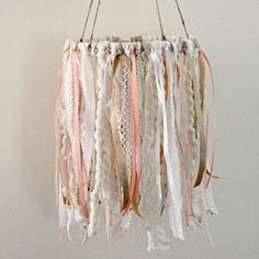 "Finish off your Boho nursery with this beautiful lace and ribbon mobile! Mobile measures 8"" across hoop, Each piece of lace and ribbon hangs approx 13"" long, Measures approx 26"" in length including the twine hanger. This mobile is made to order and may have slight differences Ships in 1-2 Weeks"