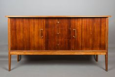 Mid Century Rosewood and Teak sideboard by Vanson Peter Hayward design by TomahawkFurniture on Etsy