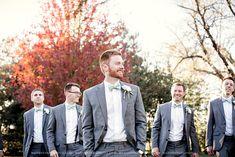 Groom and groomsmen walking in front of colorful tree
