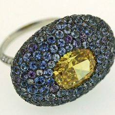Taffin Jewelry. American Montana sapphires and a client's fancy vivid yellow diamond ring, 2003. Taffin Jewelry - Alain.R.Truong