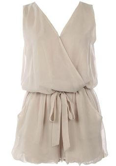 Chiffon Decadence Romper: Features a luxe wrap-over bodice with relaxed tailoring to produce a chic silhouette, easy elasticized waist for a custom fit, adjustable tonal sash at waist, and adorable romper shorts with pockets to finish.