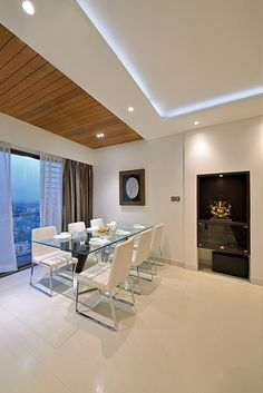 dining room with family portraits design by Amit walavalkar Adorn