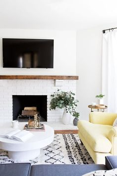 Modern Living Room With Brick Fireplace get inspired: the diy white brick fireplace | modern rustic