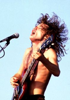 Angus Young from AC/DC.