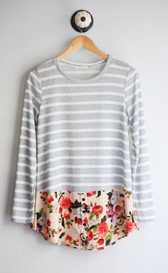 Long sleeve heather grey stripe tunic with contrasted floral design with button detail 66%Polyester, 30%Rayon, 4%Spandex Made in