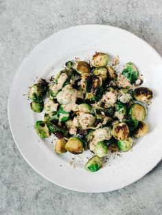 ROASTED BRUSSELS SPROUTS WITH CRANBERRIES, TAHINI + SUMAC
