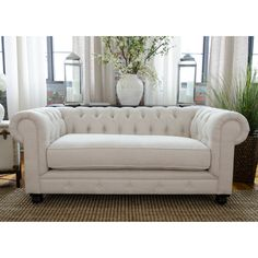 "A Chesterfield loveseat is so classic. Arms at the same height as the back make your guests feel ""sheltered"" which encourages conversation. Have to have it. Elements Fine Home Estate Fabric Loveseat - $1119.99 @hayneedle"