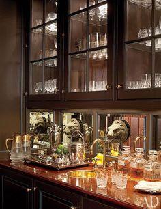 Antique lion heads ornament the mahogany bar. AD -  Fernanda Kellogg and Kirk Henckels -  Brockschmidt & Coleman