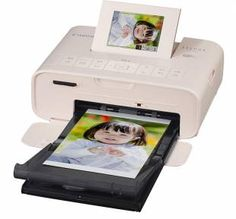 Selphy CP1200 — This portable printer is 18 cm long, 13 cm wide, 6 cm tall and just 860 grams. It can print square, post card-sized and credit card-sized images, and there are options for custom sizes as well as printing on stickers.