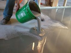 Using self-leveling polymer-modified cement to fix low spots in a garage floor