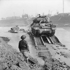An Achilles 17pdr tank destroyer of 93rd Anti-Tank Regiment crossing the River Savio on a Churchill ARK which was driven into the river, 24 October 1944.