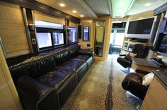 Ronnie Dunn's Tour Bus, Here's a photo of the main living space in Ronnie Dunn's tour bus during the filming of HGTV's . Like this tv living dining space except for cutting the driver almost completely off from inside.