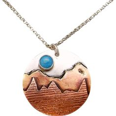 "Moon Over The Mountain Turquoise Sterling Silver And Copper Pendant Necklace  Sterling Silver 25mm pendant with a copper and brass mountain scene and 6mm turquoise ""blue moon"" cabochon on an 18"" sterling silver chain."