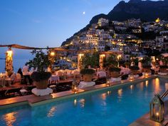 Admire the views of Italy's stunning Amalfi Coast while soaking in the pool at Le Sirenuse, which was named the best resort in Europe by Travel + Leisure.