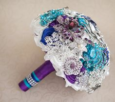 Brooch bouquet. Purple, Teal, Blue, White and Silver wedding brooch bouquet, Jeweled Bouquet. Made upon request by MagnoliaHandmade on Etsy https://www.etsy.com/listing/218462295/brooch-bouquet-purple-teal-blue-white