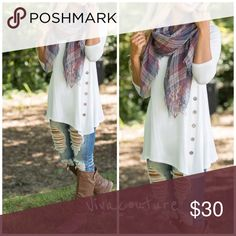New Essential Side button Tunic Restocking ivory side button tunic runs true to size nwot rayon and spandex blend . Super soft and great with jeans and leggings. Save 10% off on 2 or more items bundled . Tops