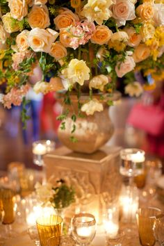 Lush peaches, butter and apricot tones in this candlelit centerpiece!  Design by Jordan Payne Events!
