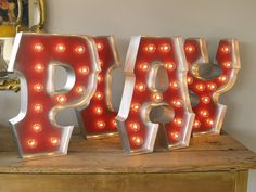 This PLAY sign will look fantastic in our customer's playroom! With his Deep Luster Silver sprayed edging and Candy Apple Red interior, these PLAY letters are ready for FUN!