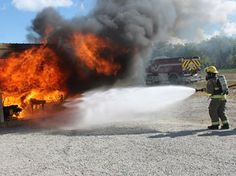 Huge crowd attends Meaford Fire Department open house - Taylor Wilkie and Dan Gillespie put out a fire demonstration at the Meaford Fire Department's open house held on Saturday, Oct. 11.