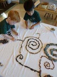 Awesome kid-made designs and art with loose rocks and other small items