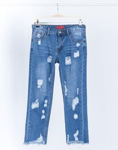 All Around Distressed Denim Jeans