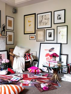 A bold and British-inspired living space with gallery wall // organized chaos