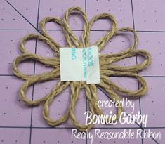 Bonnie from Really Reasonable Ribbon here today with a tutorial for an easy Jute Loopy Flower embellishment. Twine Flowers, Diy Flowers, Fabric Flowers, Paper Flowers, Sisal, Twine Crafts, Yarn Crafts, Burlap Flower Tutorial, Jute Twine