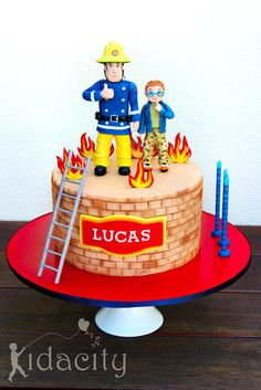 A Fireman Sam cake for his #1 fan, little Lucas. The figures are gumpaste, as are the flames. The ladder is polymer clay for durability (and I wasn't sure about the limitations of sugar!). The customers only request was that she wanted Norman...