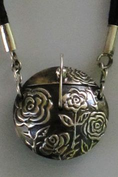 Terry Kovalcik Jewelry - Rose Garden Locket  Materials: PMC+, PMC3, PMC3 paste (.999 silver), greek leather cord, handmade SS clasp & findings;