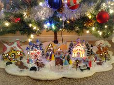 Display Christmas village under my MANY trees? Very possible and perfectly doable with a starter village. Disney Christmas Village, Disney Christmas Ornaments, Christmas Village Display, Christmas Village Houses, Mickey Christmas, Christmas Town, Christmas Figurines, Christmas Villages, Halloween Christmas