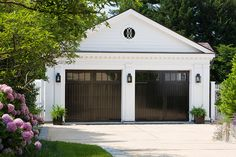 Did you remember to shut the garage door? Most smart garage door openers tell you if it's open or shut no matter where you are. A new garage door can boost your curb appeal and the value of your home. Black Garage Doors, Carriage Garage Doors, Garage Door Windows, Diy Garage Door, Modern Garage Doors, Garage Door Design, Garage Storage, Black Doors, Detached Garage Designs