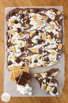 I love s'mores and I love chocolate bark. Great combo! Triple Chocolate S'mores Bark from @Jessica l A Kitchen Addiction