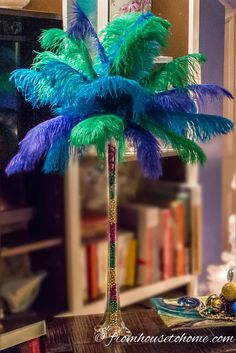 Learn how to make feather centerpieces with this step-by-step tutorial. DIY Ostrich feather centerpieces are perfect for weddings, Mardi Gras masquerade parties, Great Gatsby parties and all kinds of Ostrich Feather Centerpieces, Mardi Gras Centerpieces, Masquerade Centerpieces, Mardi Gras Decorations, Masquerade Party, Wedding Centerpieces, Balloon Centerpieces, Masquerade Masks, Centerpiece Decorations