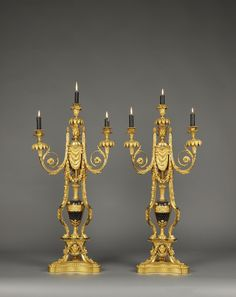 Beurdeley. An Exceptional Quality Pair of Napoleon III Gilt-Bronze and Enamel Four-Light Candelabra, After the Model by Pierre Gouthière.  French, Circa 1870.