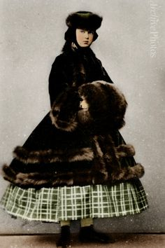 Maria Alexandrovna poses in a crinoline dress for a girl and fur hat, paletot, and muff in this photo