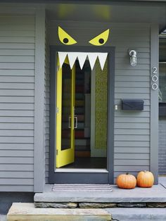 """View the photo This photo provided by FamilyFun/Meredith Corp. shows the halloween decoration, """"Nice to Eat You."""" Quickly make an amusing Halloween front door with craft foam: Using removable foam-mounting squares, attach pointy white teeth so they hang from inside the door frame and two large, yellow eyes with black pupils mounted above the doorway. Find this and other Halloween crafts online at FamilyFun magazine. (Alexandra Grablewski/FamilyFun/Meredith Corp. via AP) on Yahoo News. Find…"""