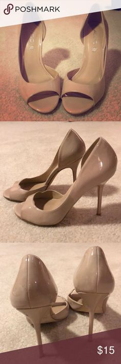 Aldo Patent Nude Peep Toe Heels Aldo Patent Nude Peep Toe Heels. Some stuff marks and blue stain on heel of left shoe. Shown in pics. Blue stain is not visibly noticeable when wearing since it's on the underside of heel. Size 37 Aldo Shoes Heels