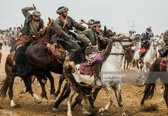 Afghan horsemen try to get a calf carcass during the Buzkashi game in Mazar-i Sharif, Afghanistan.