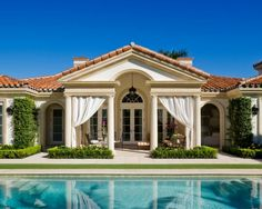 Swoon-Worthy Swimming Pools | Poolside perfection | Courtesy of Palm Beach, Florida's Kirchhoff & Associates Architects | Classic elegance