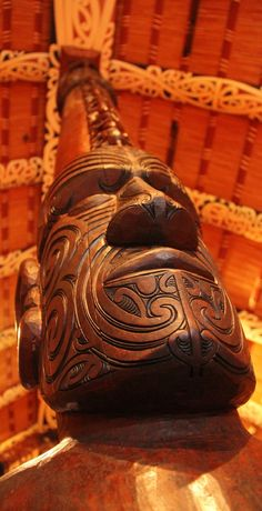 Maori Carving - Totem detail inside a Maori Community House on the Waitangi Treaty Grounds, NZ