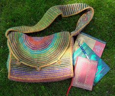 This messenger bag is pieced as it is knit - so, there is minimal sewing to do at the end! - then felted. Instructions are written - no need for charts here - and there are instructions included for the optional lining.