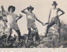 Teens in north Queensland, Australia in the 1930s. What's the guy on the left holding?