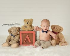 Handsome 6 month old baby boy sitting by a big block in between some bear friends. Bow tie Precious Baby Photography by Angela Forker creative photography unique cute Fort Wayne New Haven Indiana