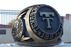 The bronze sculpture of the Texas Tech official class ring is located southeast of the Merket Alumni Center. Raiders Stuff, Texas Tech Red Raiders, Texas Tech Logo, Lubbock Texas, Texas Tech University, Bronze Ring, Graduation Pictures, Take That, Traditional