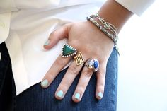 vintage bracelet, a thai evil eye bracelet, a bing bang bracelet, and a collection of rings from mexico, key west, and custom horseshoe ring by Alushia Sanchia.