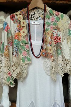 Short jacket made w/vintage dresser scarves, handkerchiefs, crocheted doilies and bits of fabric