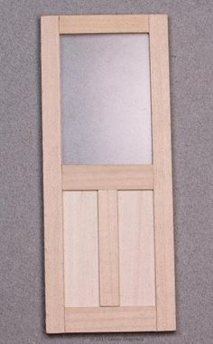 Simple dolls house door with window and panel trim. - Photo © 2011 Lesley Shepherd https://www.thespruce.com/make-model-hinges-from-scrap-metal-2366845?utm_campaign=shareurlbuttons_nip&utm_medium=social&utm_source=pinterest#step9