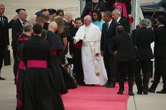 Pope Francis shakes hands with Vice President Joe Biden along with U.S. President Barack Obama, first lady Michelle Obama, and other political and Catholic church leaders after arriving from Cuba September 22, 2015 at Joint Base Andrews, Maryland. Francis will be visiting Washington, New York City and Philadelphia during his first trip to the United States as Pope.