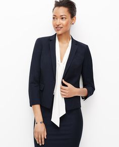 """Get in line: dressed in fine pinstripes, this impeccably tailored jacket gets the job done. Wear it head-to-toe or mix-and-match with a bright pop of contrast color. Notched lapel. 3/4 sleeves with functional sleeve buttons for added styling options. One-button front. Front flap besom pockets. Back peplum. Lined. 22 3/4"""" long."""